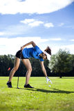 Pretty girl playing golf on grass. In summer Stock Photos