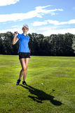 Pretty girl playing golf on grass. In summer Royalty Free Stock Photos