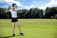 Pretty girl playing golf. On grass in summer Royalty Free Stock Photos