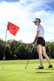 Pretty girl playing golf on grass Royalty Free Stock Images
