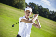 Pretty girl playing golf on grass Royalty Free Stock Image