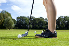 Pretty girl playing golf on grass. In summer Stock Photo