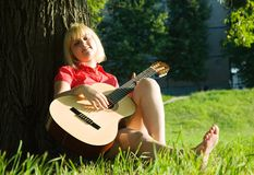 Pretty girl playing guitar Stock Photo