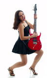 Pretty girl playing red electric guitar Stock Photo