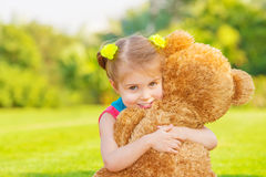 Happy girl with soft toy Stock Image