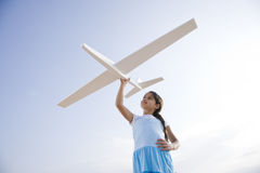 Pretty girl playing with toy glider Stock Image