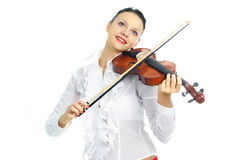 Pretty girl playing the violin Royalty Free Stock Images