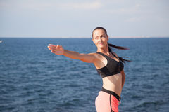 Pretty girl plays sports fitness on the beach Royalty Free Stock Photos