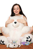 Pretty girl plays with a teddy bear Stock Images