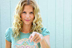 Pretty girl pointing her finger accusingly Stock Images