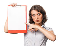 Pretty girl points to the clipboard Royalty Free Stock Photography