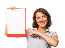 Pretty girl points to the clipboard Royalty Free Stock Images