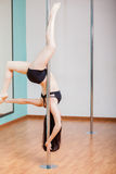 Pretty girl pole dancing Royalty Free Stock Photo