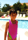 Pretty Girl at Pool. Pretty girl standing near a swimming pool Royalty Free Stock Photo