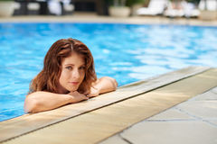 Pretty girl in pool Royalty Free Stock Image