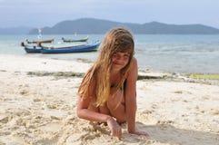 Pretty girl portrait on sandy beach Stock Photo