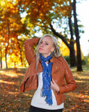 Pretty girl posing in autumn park Royalty Free Stock Photos
