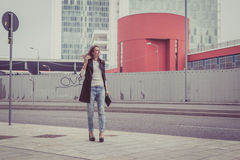 Pretty girl posing in the city streets Royalty Free Stock Photography