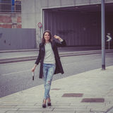 Pretty girl posing in the city streets Royalty Free Stock Photos