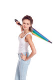 Pretty girl posing with color umbrella. On white background royalty free stock photo