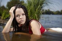 Pretty girl posing in the lake Stock Photos