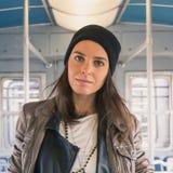 Pretty girl posing in a metro car Stock Photos