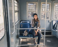 Pretty girl posing in a metro car Royalty Free Stock Images