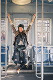 Pretty girl posing in a metro car Royalty Free Stock Photography