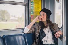 Pretty girl posing in a metro car Stock Photo
