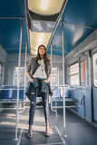 Pretty girl posing in a metro car Stock Images