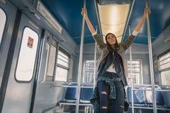 Pretty girl posing in a metro car Royalty Free Stock Image