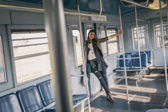 Pretty girl posing in a metro car Stock Photography