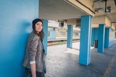 Pretty girl posing in a metro station Stock Photos
