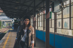 Pretty girl posing in a metro station Stock Image