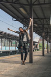 Pretty girl posing in a metro station Royalty Free Stock Image
