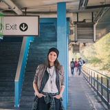 Pretty girl posing in a metro station Royalty Free Stock Images