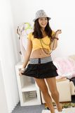 Pretty girl posing in mini skirt smiling. Pretty teenage girl posing in mini skirt, laughing Royalty Free Stock Images