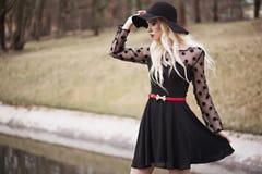 Pretty girl in posing outdoors Stock Photos