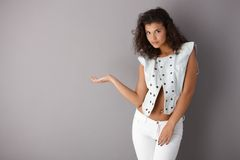 Pretty girl posing over gray background Stock Photos