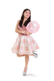 Pretty girl posing with pink balloon Stock Photography