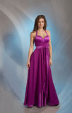 Pretty girl posing in plum violet evening dress. Full-length portrait of a pretty girl posing in plum violet evening dress, gray background Stock Photo