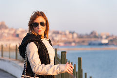 Pretty Girl Posing on the Seaside royalty free stock images