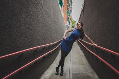 Pretty girl posing in a urban underpass Stock Photo
