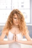 Pretty girl practicing yoga prayer pose Stock Images