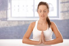 Pretty girl practicing yoga prayer pose Stock Photography