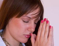 Pretty girl praying Stock Photos