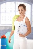 Pretty girl prepared for workout in gym Royalty Free Stock Photo