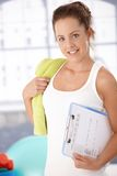 Pretty girl prepared for workout in gym Royalty Free Stock Image