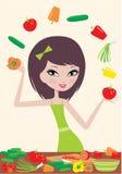 Pretty girl prepares salad and juggles with vegeta Stock Image