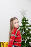Pretty girl preparing the christmas tree Stock Photography